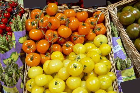 fresh red and yellow cherry tomatoes at the market
