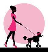 Female silhouette with a dog on a leash