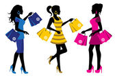 Three elegant female silhouette with shopping bags on white background