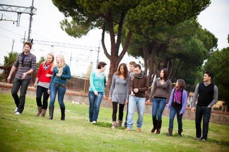 Multicultural Group of Walking Together