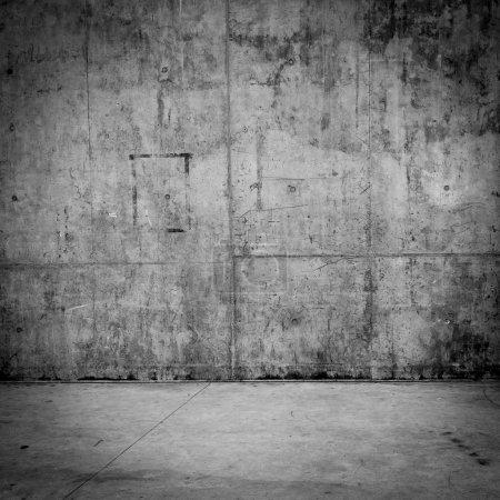 Grungy muro de hormigón y el suelo como fondo