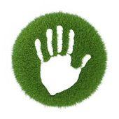 Tisknout lidské ruce na zelené trávě