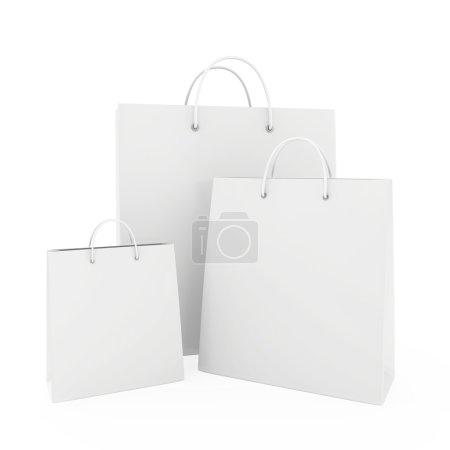 Photo pour Trois sacs en papier blanc blanc - image libre de droit