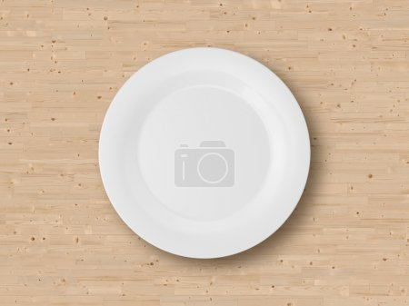 Photo for Empty plate on wooden table. - Royalty Free Image