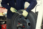 Changing a tire in a garage