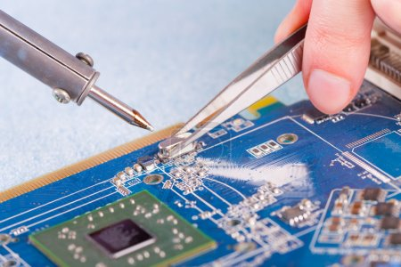 Photo for Using soldering tool for the computer parts. - Royalty Free Image