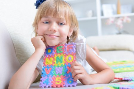 little girl with alphabet puzzle