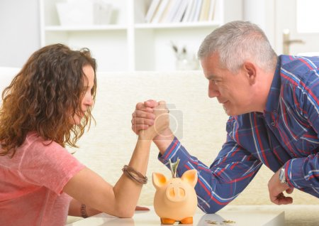 Couple doing armwrestling