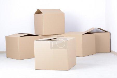Big cardboard boxes standing insinde a room...