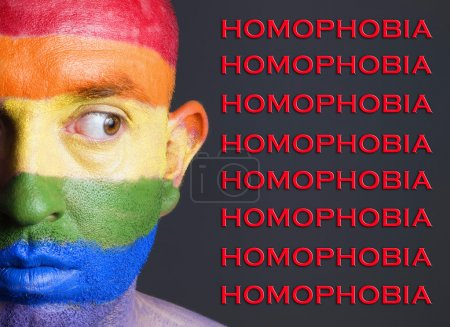 Gay flag face man, homophobia concept