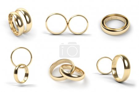 Photo for Set of gold wedding rings engraved with the text Newlyweds - Royalty Free Image
