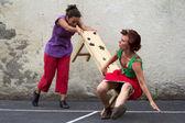 Dancer knocking over a bench