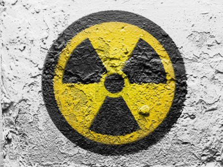 Nuclear radiation symbol painted on grunge wall