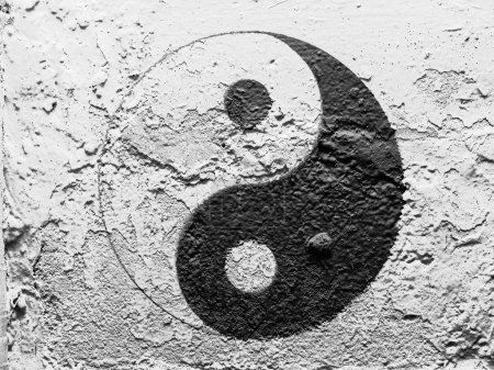 The Ying Yang sign painted on grunge wall