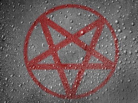 Pentagram symbol painted on metal surface covered ...