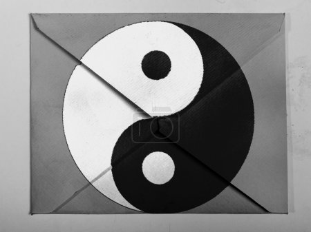 The Ying Yang sign painted on painted on grey envelope