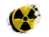 Nuclear radiation symbol painted on painted with brush on white background