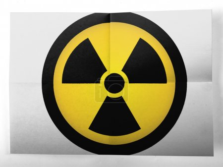 Nuclear radiation symbol painted on simple paper sheet