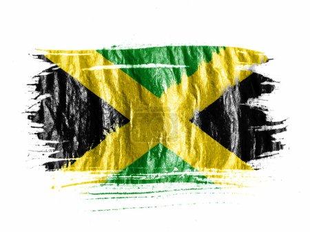 Photo pour Drapeau de la Jamaïque peint avec l'aquarelle sur papier blanc humide - image libre de droit