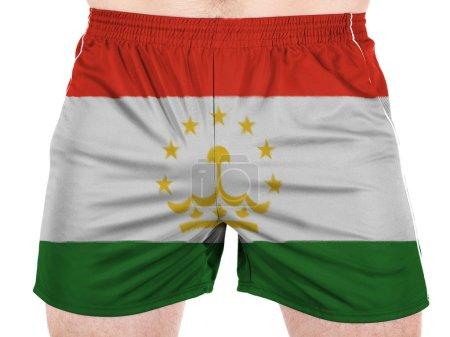 Photo pour Le drapeau du Tadjikistan peint sur chemises sport - image libre de droit