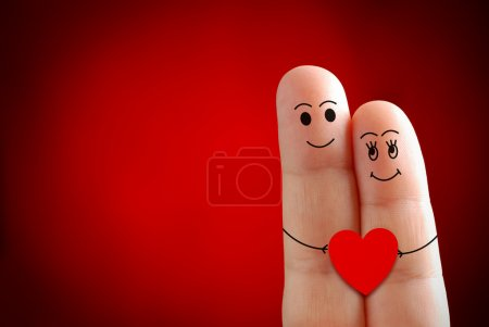Photo for A happy couple in love with painted smiley, valentines day - Royalty Free Image