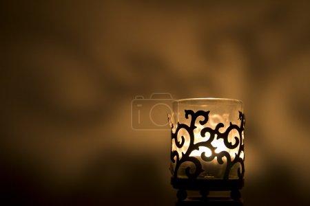 Jar candle holder on a golden background...