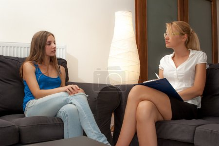 A sexy female psycotherapist treats a teenage female patient