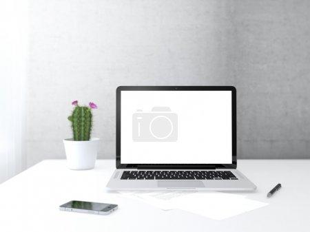 Photo pour Lieu de travail avec appareils électroniques sur le bureau à côté du mur et de la fenêtre - image libre de droit