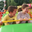 Children have fun riding on rollercoaster...