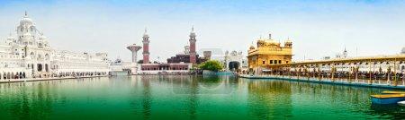 Photo for Pilgrims in main Sikh Gurdwara the Harmandir Sahib also known as Golden Temple. Amritsar, Punjab, India - Royalty Free Image