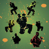 Paintball players silhouettes with grunge drops vector illustration