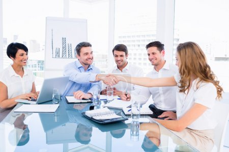 Executives shaking hands during a business meeting