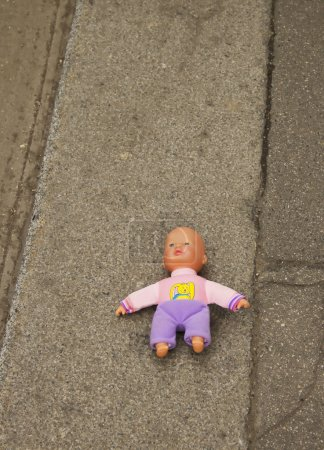 Photo for Abandoned Doll lie on the ground - Royalty Free Image