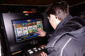 Player at the slot machine