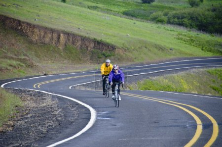Two bicycle riders on rural road
