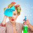 Funny housewife with rag wipe and cleaning spray f...