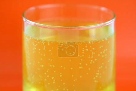 A glass of orange flavored calcium effervescent tablet
