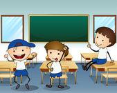 Three boys laughing inside the classroom