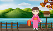 Illustration of a girl wearing a kimono holding a lantern beside a wooden mailbox