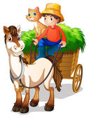 A young boy with a horse and a cat