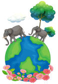 Two elephants walking at the earth's surface