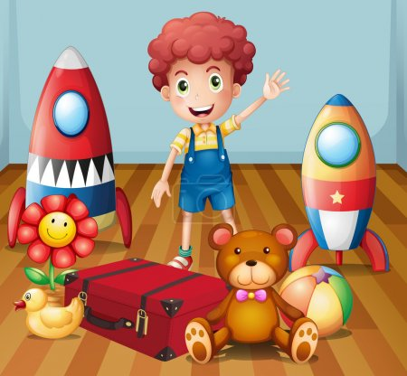 A young boy with his toys inside the room