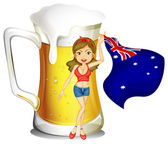 A girl with the flag of Australia in front of the big mug of bee