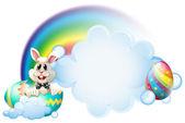 A cracked egg with a bunny near the rainbow