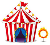 A circus tent beside a ring of fire