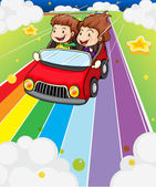 Two kids riding in a red car