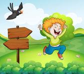 A black bird and a happy boy near the arrow signage