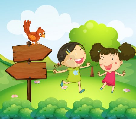 Two girls playing beside the two arrow boards
