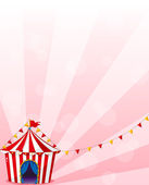A red circus tent with banners