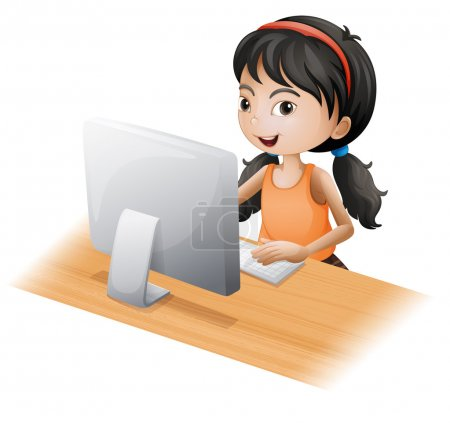 A young girl using the computer